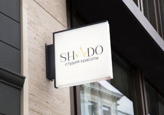 Студия красоты SHADO с фирменной короной на логотипе